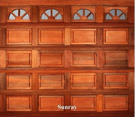 A wooden garage door in Sunray style.