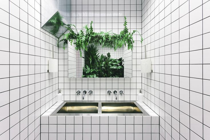Orang+Utan Vegetarian Cafe Features Stark White Tiling And Neon Signage | Interior Design inspirations and articles