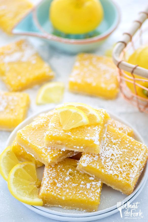 Easy and delicious gluten free lemon squares. They're not too tangy and just sweet enough! Perfect for Easter, bridal showers, baby showers, or any dessert table. Recipe from @whattheforkblog | whattheforkfoodblog.com | AD by @bobsredmill BobsSpringBaking | lemon bars | gluten free desserts | easy gluten free recipes | Spring desserts | lemon custard with shortbread crust | best recipes | gluten free baking