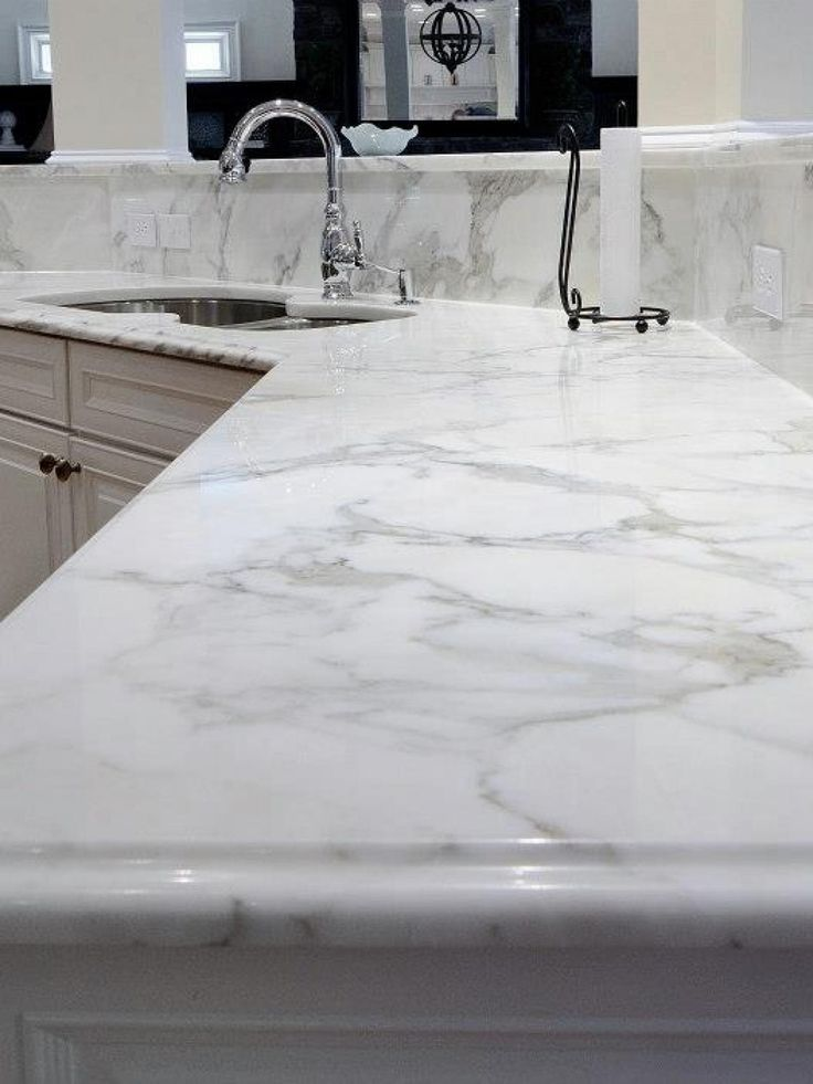 Calcutta quartz counter top - looking at this for the bathroom countertops
