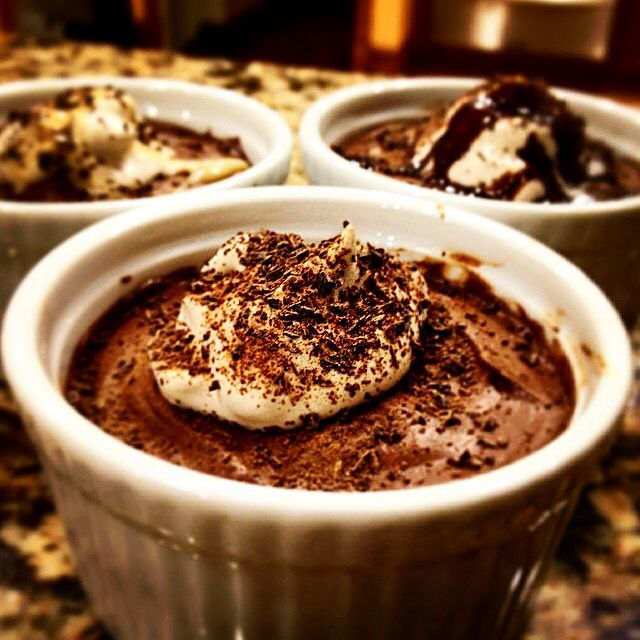 Fluffy chocolate mousse with whipped cream and shaved chocolate