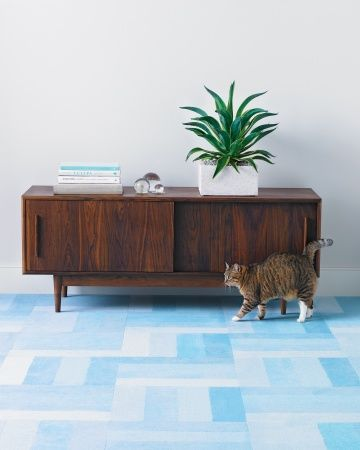 The Pattern: Ombre To re-create this tonal parquet-style floor, use Flors Modern Mix kit, which includes carpet tiles in four shades of the same color. Cut each tile into four equal strips, and reattach the strips -- one of each shade, from light to dark -- to form a square ombre tile. Alternate the positioning of the tiles so the stripes run horizontally, then vertically. Modern Mix in Blue,flor.com.Grove storage cabinet,