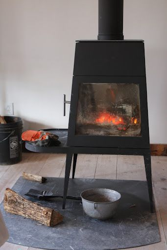 The large studio space is made cozy by this wood-burning stove.  It's a Shaker design made by Wittus.  http://www.wittus.com/