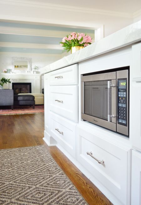 Thinking about a microwave under the counter to free up space and get it off the counter? Here's what we considered and how we like it