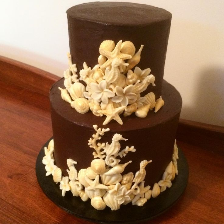 Orange and dark chocolate wedding cake finished with