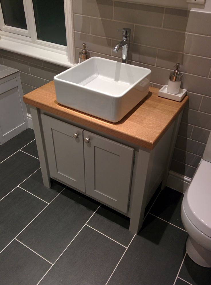Manor house grey with a solid oak top vanity unit. All our vanity units are made to measure so they fit into your bathroom perfectly.This vanity unit has brushed chrome handles which match the other metal in the bathroom. Visit www.aspennfurniture.co.uk to view some more of our vanity units and design your own. Contact us on 01937 843386 / ianaspenn@btinternet.com