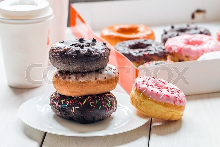 """Delicious food photography: """"Fast food breakfast with donut and coffee."""" Photo made by Petr. Folloe his amazing job here: https://www.colourbox.com/supplier/petr-105802"""