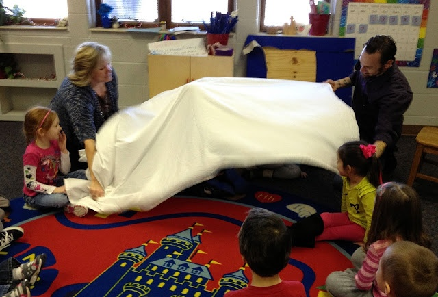 """Ideas for """"The Mitten"""" storytime! Using a sheet, have kids crawl under as animals get into the mitten, then when the bear sneezes everyone comes out. This teacher gave each of the kids an animal card so they would know when to crawl in and read twice so everyone could get a turn."""