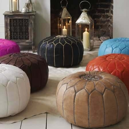 For ze-feet!    What about a coffee table that is sofa height to put your feet on and these as additional foot rests/seating....  Colourful Moroccan leather poufs.  $179.00 NZD                                                         Free Shipping Australasia