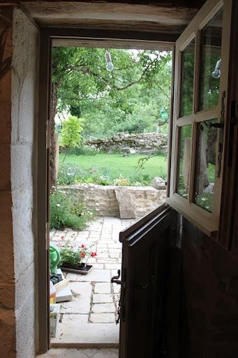 Dutch door to stone patio...