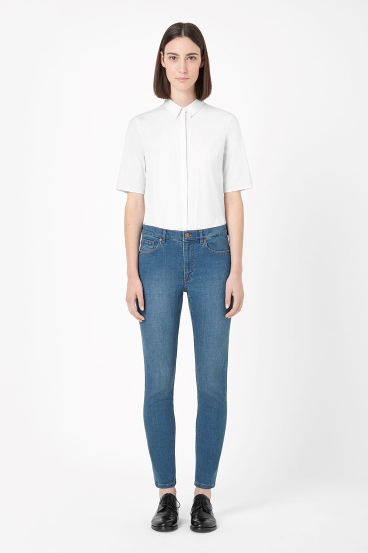 An easy-to-wear style, these classic slim-fit jeans are made from crisp denim with a soft worn finish. A cropped style that sits high on the waist, they have a bit of a stretch for comfort and are finished with matte metal hardware.