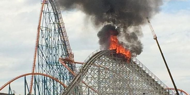Colossus, a 36-year-old wooden roller coaster at Six Flags Magic Mountain in Valencia, Calif., caught fire on Monday and partially collapsed.   The park was closed at the time of the fire and no one