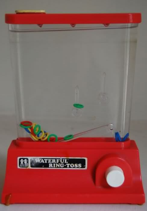 Waterful Ring Toss ....OMGosh, I had one of these! Totally forgot about it until now!