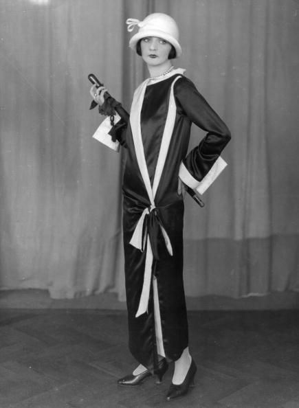 An ankle grazing evening coat dress, heels, and a cloche hat, 1924.