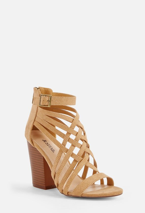 a789e9fa66b Sexy and strappy is Nashia s style. Step into this sassy faux suede heel  featuring a block heel and back zip closure. You ll be able to strut all d…