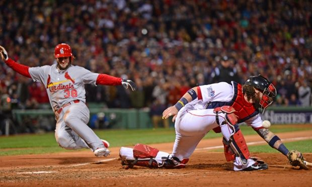 Pete Kozma scores the game tying run for the St Louis Cardinals against the Boston Red Sox in the 7th inning of game two of the World Series. The Cardinals would go on to win the game 4-2, tying the World Series at 1-1.