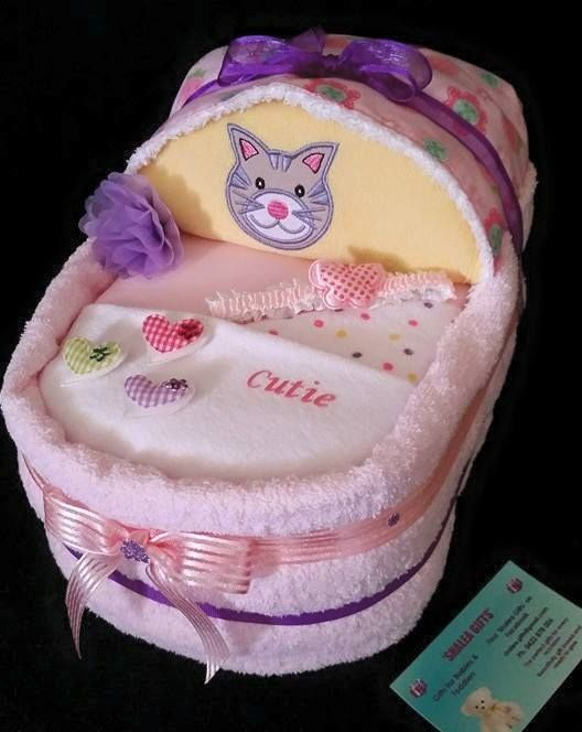 Small  Bassinet Baby Gift- Girl Contains –  30 Infant Nappies 1 x Baby Singlet  000 1 x Long Sleeve Onsie 000 1 x Plain Baby Feeding Bib 1 x Embroidered Baby Bib 1 Burp Cloth 1 x Pink Baby Towel 2 Baby Wash Cloths Decorated/Embellished Finished with Cellophane and  Ribbon  Complimentary gift – Baby Headband