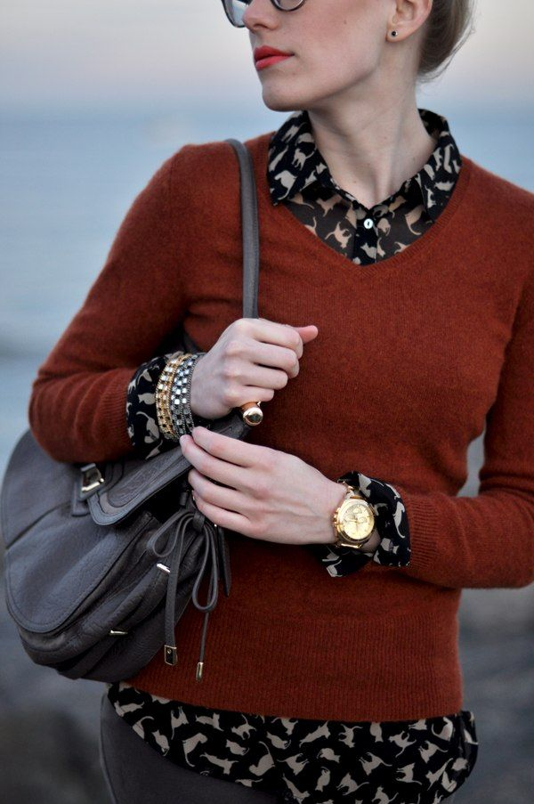 Lovely rust sweater layered over blouse. Not loving the cat print :-/