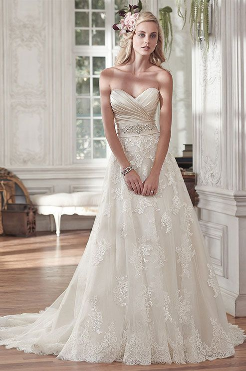 Timeless and elegant, this romantic lace and tulle A-line wedding dress features a stunning L'Amour satin pleated bodice and lightweight lace and tulle skirt, accented with a delicate Swarovski crystal embellishment at the waist. Maggie Sottero Spring 2016 wedding dress collection