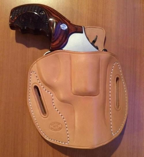 Revolver Pancake holster in un-dyed natural leather.
