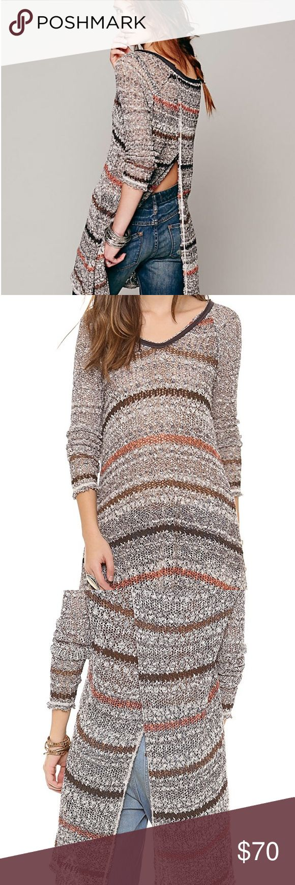 Free People Life's a Beach Tunic Amazing Life's a Beach tunic by Free People! Loose knit striped tunic with an A-line silhouette and long sleeves. Features a crossover style slit, which extends the entire length of the garment, on the back. The perfect, unique piece to add to your wardrobe for this fall! Distressed hem and sleeves detail. Great condition! Make an offer or 'add to bundle' and I will send you a personal discount! ❤️ Free People Tops