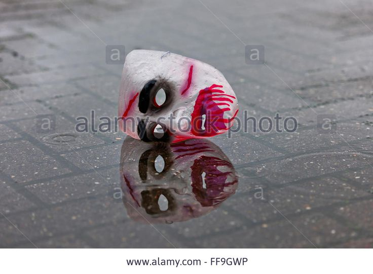 Carnival Mask On The Street In A Pool Of Water After It Has Been Lost Stock Photo, Picture And Royalty Free Image. Pic. 95482514