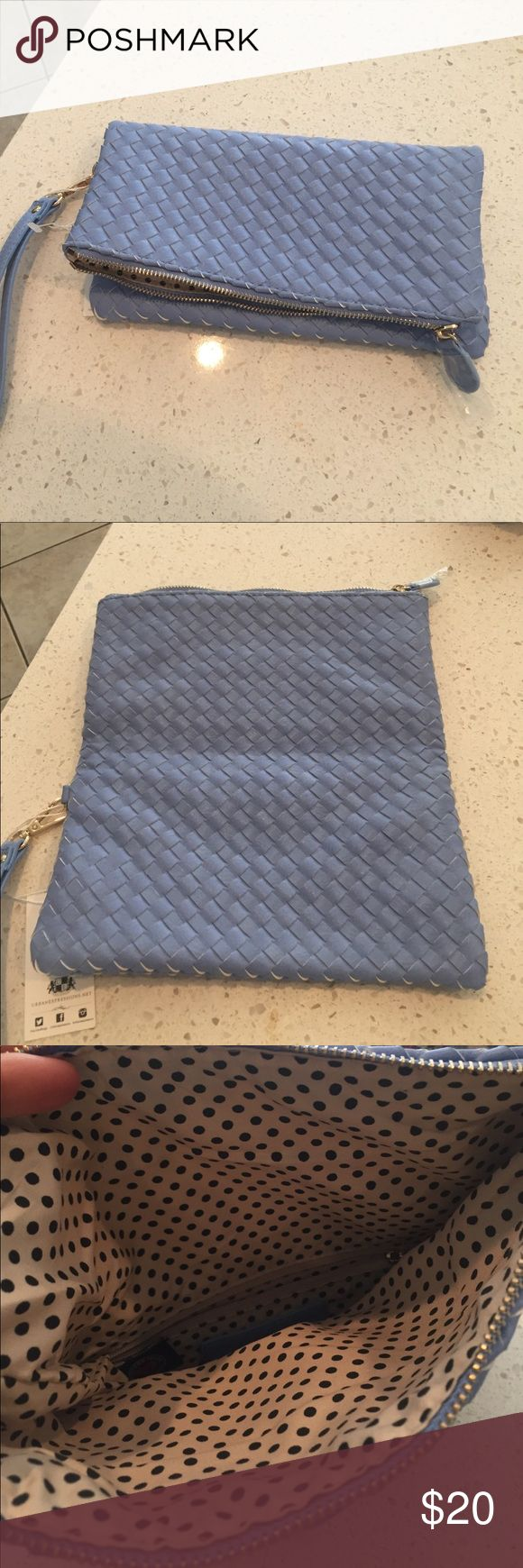 Light blue clutch bag Holds together with magnet .. light blue leather. Brand new. Detachable wristlet.. never been used.. tags attached Bags Clutches & Wristlets