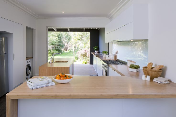 Get the look - nougat truffle thermoformed doors and panels in modern profile. 50mm bamboo benchtops. discreet grip handles... +kaboodle kitchen