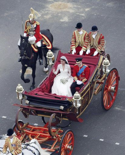 The Duke and Duchess of Cambridge travel in a 1902 State Landau along the Procession Route after their wedding in Westminster Abbey