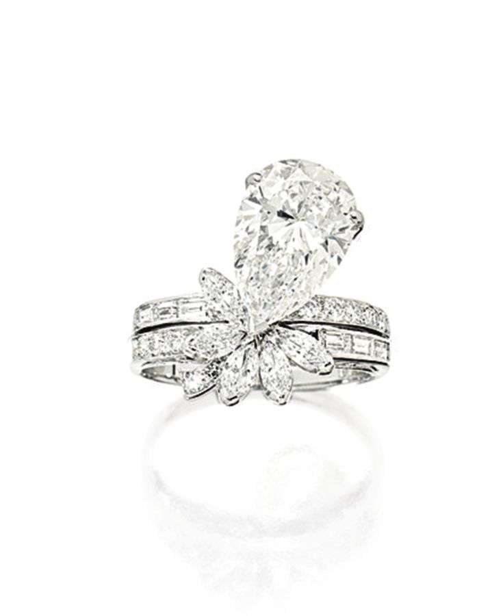 Diamond Ring. Set with a pear-shaped diamond weighing 4.20 carats,  embellished with