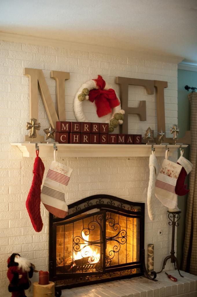 I would love this to be my mantel this year!  going for a vintage/red thing.  i love it!