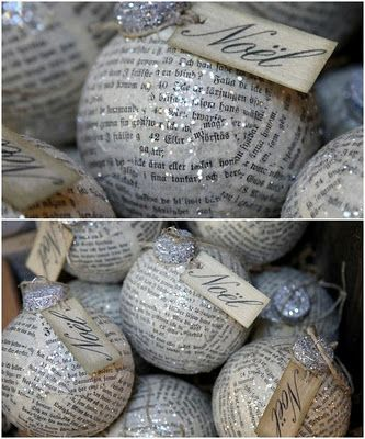 "Clear, glass ornaments decoupaged with vintage papers, sprinkled with glass glitter and tied with ""Noel"" made on a printer. Would be neat to use pages from a discarded Christmas book."