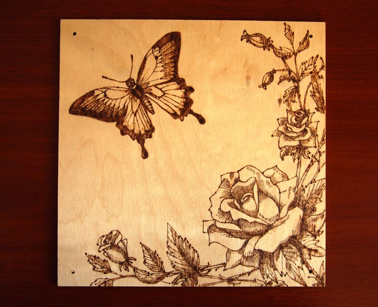 Butterfly with roses. This is my first wood burning ever :) It was made by a pyrography kit I bought in the Lidl, but it worked good I think. Ok, that was my first try, and I don't know any other pyrographs, but I like the result.  Wood burning and design by Kölyök