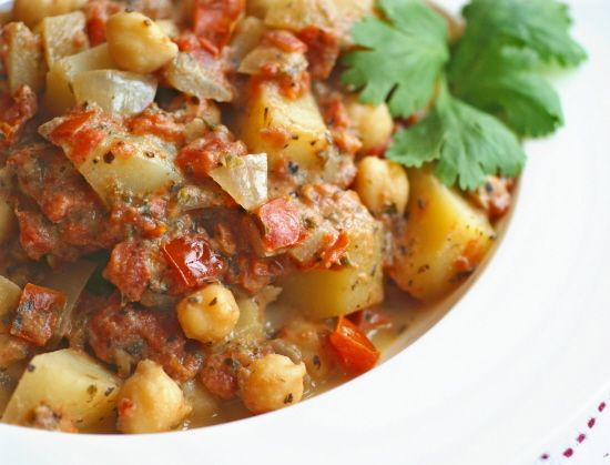 Chick pea, potato & tomato stew. Cooking dinner for a vegan friend this week...researching recipes...this look's good?!!