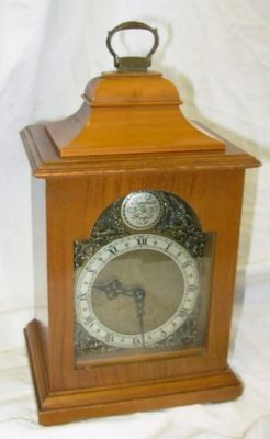 walnut bracket clock by rotherham for restore walnut clock by rotherham,gains a couple or 3 hours a day,so sold for spaares or repair.clock stands at 9 3/4 inch to top of handle,width 5 1/2 inch,depth