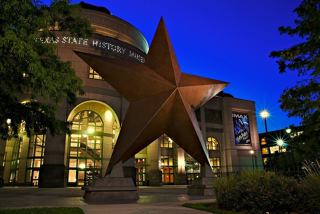 "The Bob Bullock Texas State History Museum in downtown Austin tells the ""Story of Texas"" with three floors of interactive exhibits & shows. A 35-foot-tall bronze Lone Star sculpture greets visitors in front of the Museum, and a colorful terrazzo floor in the Museum's rotunda features a campfire scene with enduring themes from Texas' past. The Museum also has a Cafe with indoor and outdoor seating and a Museum Store with something for the Texan in everyone."