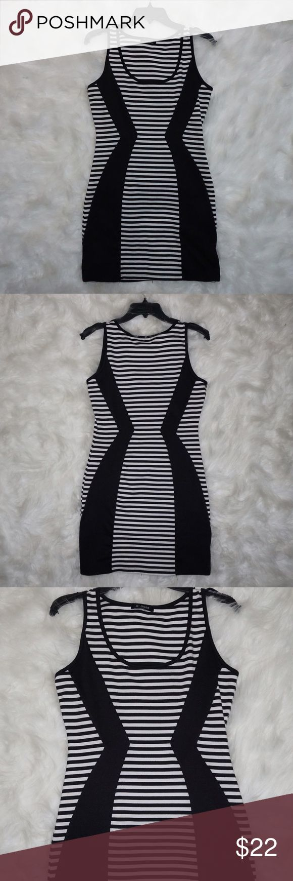 Stripe body con dress! Slightly used body con dress! •size L •material is not thin but not too thick as well. Not sure exactly but it's a good material! •the way the black is designed on it makes your curves pop! •super cute for a night occasion😉 Dresses Mini