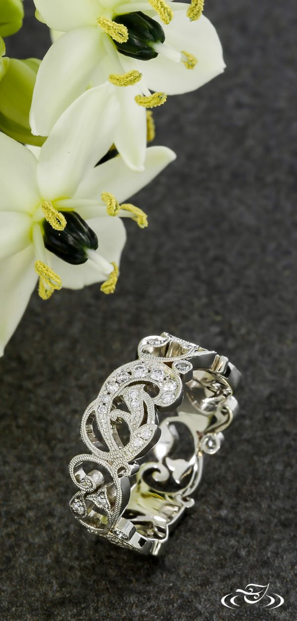 Pierced lace diamond band with milgrain edges. Green Lake Jewelry
