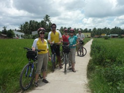 We cycled the Mekong Delta in August - Monsoon Season - less tourists, lush rice fields & an afternoon rain storm to cool things down - just loved it.