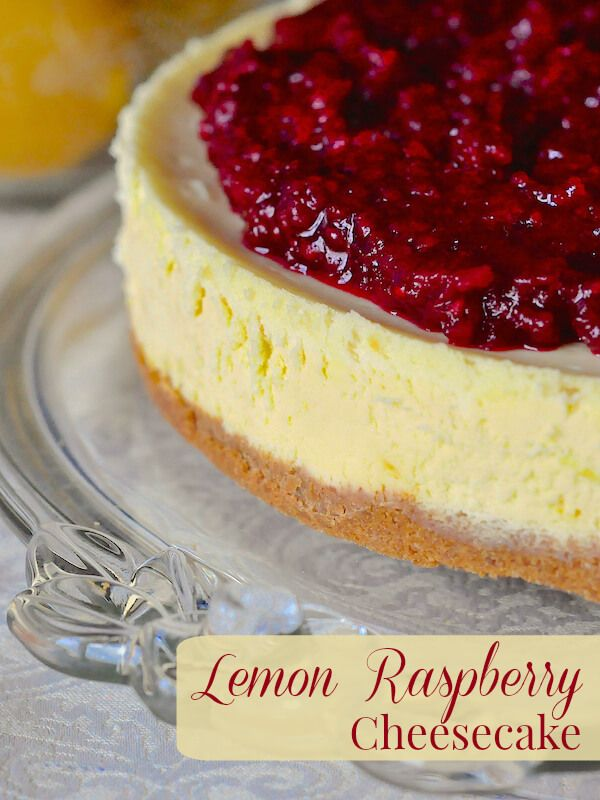 Lemon Raspberry Cheesecake - a silky smooth lemon cheesecake with just the right tangy lemon flavour topped by a complementary sweet raspberry compote.