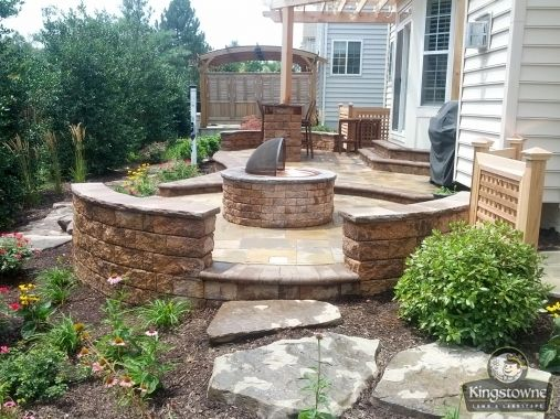 Stunning 2 level paver patio with block seat wall fire for Garden design level 3