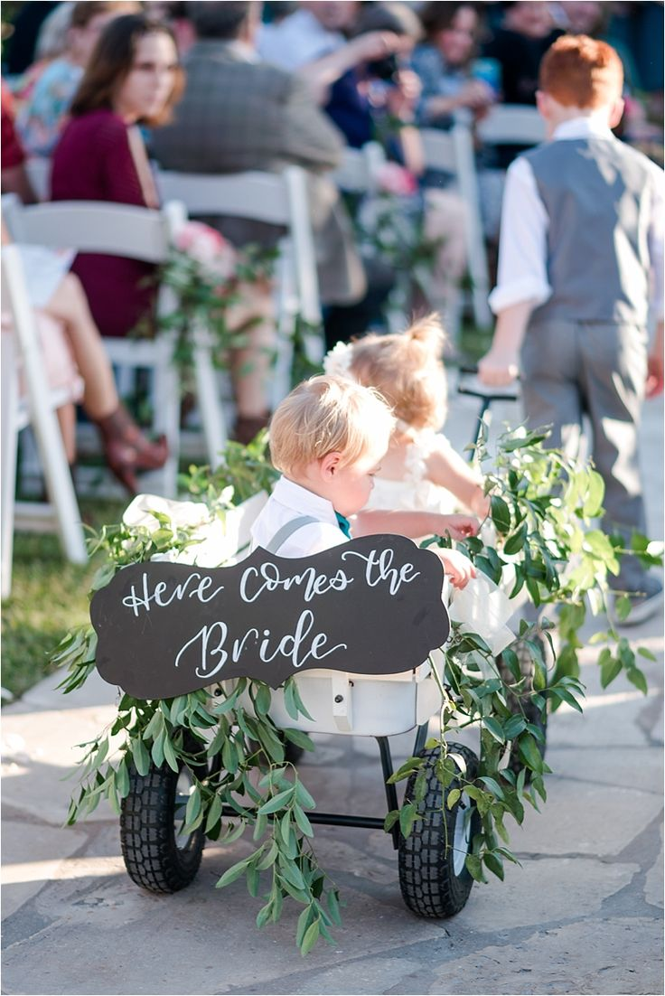 "Cutest chalkboard sign for your flower girl//ring bearer to carry down the aisle before you walk down! ""Here comes the bride."" Taken at THE SPRINGS in Georgetown by Angela Lally Photography."