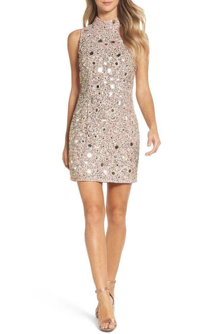 Sparkle throughout the party season in this statement mini embellished with sequins and mirrors rimmed in golden thread for head-to-toe shimmer.