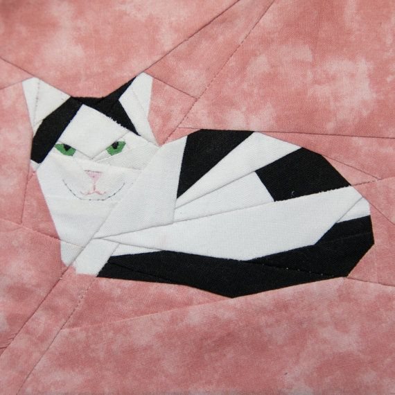 This pattern is based on our first cat, Precious. It is a 5x 5 block (5.5 x 5.5 with seam allowance). Of course you can enlarge the pattern if desired; it does have some itty-bitty pieces! I would be happy to enlarge it for you to whatever size you need. I added the details (pupils, mouth, chin) with a little embroidery floss.    When you purchase this pattern, you will be able to download the PDF file. The pattern is full-color and clearly numbered/lettered.    Basic paper-piecing…