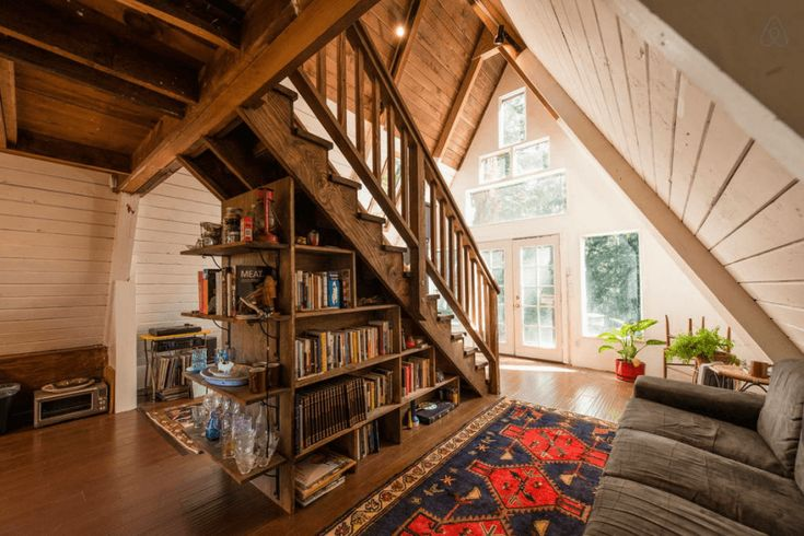 Wooden A-Frame Cabin in the Redwoods interior shelves and staircase
