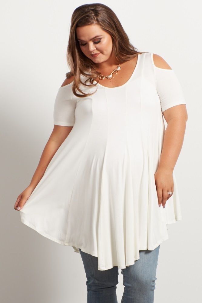 A solid plus maternity tunic. Rounded neckline. Open shoulder cutout.