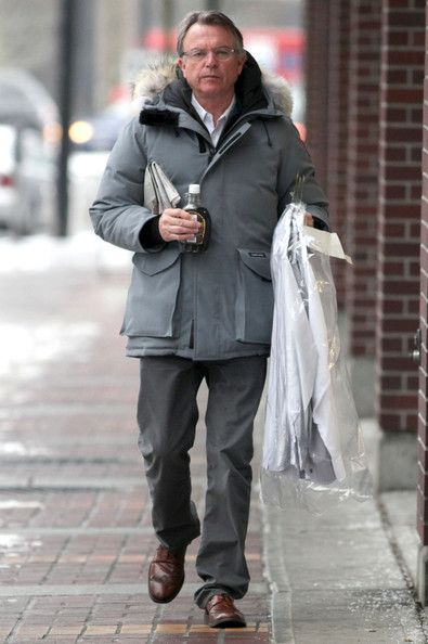 """Sam Neill Photos Photos - """"Jurassic Park"""" star Sam Neill picks up dry cleaning and a bottle of Canadian maple syrup while running errands on day off from filming """"Alcatraz"""" on January 20, 2012 in Vancouver, Canada. - Sam Neill Can't Resist The Canadian Maple Syrup"""