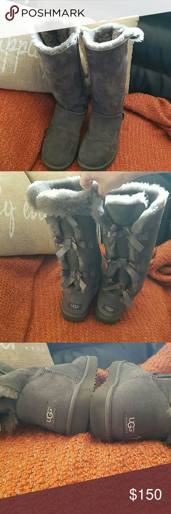 AUSTRALIAN UGG BOOTS?????? Brand new worn 3 times.... tall UGGS boots with three gray bows on the back. Flawless. It's too hot where I live... can never where them! Make your best offer! UGG Shoes
