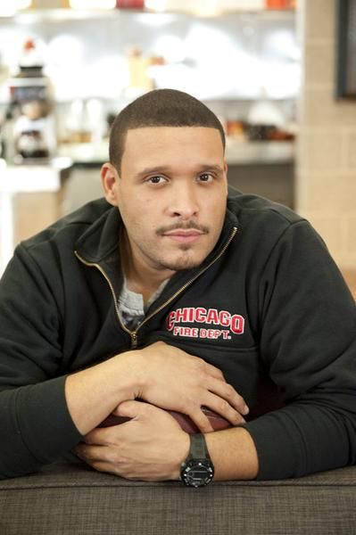 "Joe Minoso hanging out at fictional Firehouse 51 as Chicago Fire's ""Joe Cruz"" 