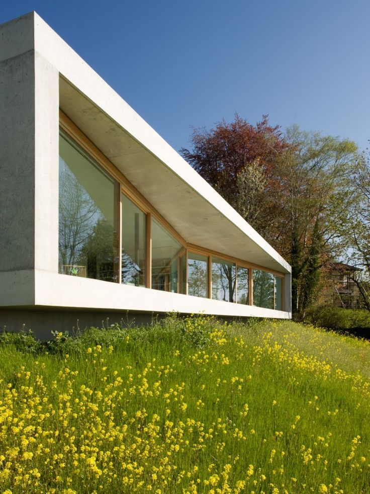 I'm liking the not-so-subtle, yet simple angle of that facade. Gauthier House by bauzeit architekten in Switzerland.
